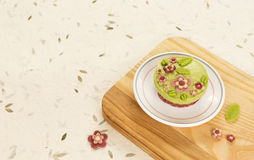 Raw vegan spinach cake with the raw marzipan flowers and leaves Royalty Free Stock Photography