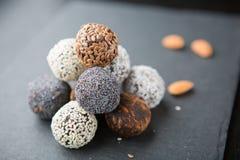 Raw vegan sweet cocoa balls. Raw vegan sweet cocao balls. Vegetarian healthy food concept.Stuffed with chopped almonds, walnuts, hazelnuts and cashew stock photos