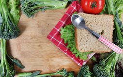 Raw vegetable sandwich. Beautiful shot showing brown bread sandwich with vegetables in border Royalty Free Stock Photos