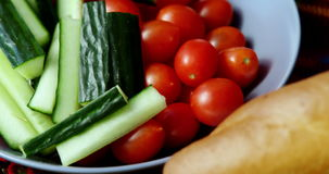 Raw vegetable, tomatoes and loaf of bread. Close-up of raw vegetable, tomatoes and loaf of bread stock footage