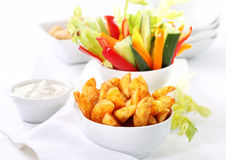 Raw vegetable and wedges with dip Royalty Free Stock Photos