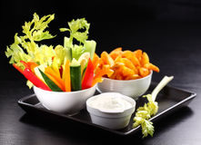 Raw vegetable and wedges with dip Stock Photo