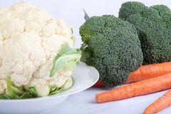 Raw Vegetables. Assorted raw and fresh vegetables containing broccoli, cauliflower, and carrots Stock Photos