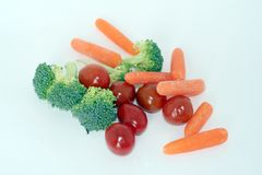 Raw Vegetables. Baby carrots, broccoli and cherry tomatoes stock images