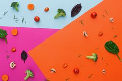 Raw vegetables on abstract background, flat lay. Diet, detox and healthy food concept - top view flat lay of fresh organic raw vegetables on abstract bright Royalty Free Stock Image