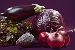 Raw vegetables against purple background Stock Photos