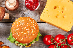 Raw vegetables and burger. Stock Photography