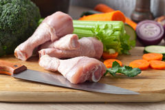 Raw vegetables with chicken drumsticks Royalty Free Stock Photos