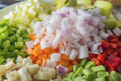 Raw vegetables con on dices Royalty Free Stock Image