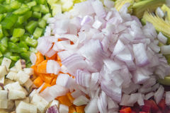 Raw vegetables con on dices Stock Photography