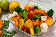 Raw vegetables cut into pieces in a bowl. Several kinds of vegetables prepared meal laid on a table Stock Photography