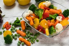 Raw vegetables cut into pieces in a bowl. Several kinds of vegetables prepared meal laid on a table Stock Images