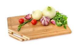 Raw vegetables on cutting board on white background Stock Images