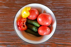 Raw vegetables on the dish. Top view. Royalty Free Stock Image