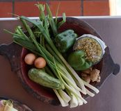 Raw vegetables and eggs in oval dish Royalty Free Stock Photography