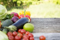 Raw vegetables and fruits on wooden table and blur background. C. Opy space stock photo