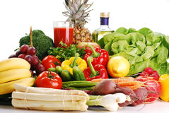 Raw vegetables and glass of juice Royalty Free Stock Photos