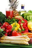 Raw vegetables and glass of juice. Freshly washed vegetables with visible drops of water and glass of vegetable juice Royalty Free Stock Photography