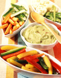 Raw vegetables and guacamole dip Stock Photography