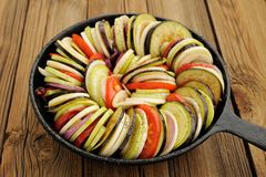 Raw vegetables layed for ratatouille made of eggplants, squash, Royalty Free Stock Photo