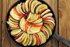 Raw vegetables layed for ratatouille made of eggplants, squash, Stock Image