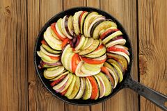 Raw vegetables layed for ratatouille made of eggplants, squash, Royalty Free Stock Photography