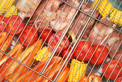Raw vegetables and meat on a grille Stock Photo