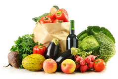 Raw vegetables and shopping bag isolated on white Royalty Free Stock Photography