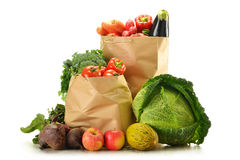 Raw vegetables and shopping bag isolated on white Stock Image