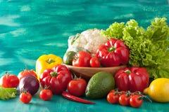 Raw vegetables tomato pepper avocado onion cauliflower lettuce Stock Photo