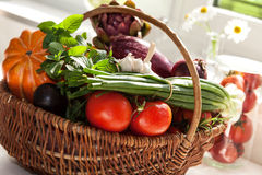 Raw vegetables in wicker basket Stock Photography