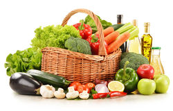 Raw vegetables in wicker basket on white. Composition with raw vegetables in wicker basket on white Royalty Free Stock Image