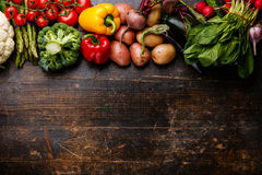 Raw vegetables on wooden background. Fresh raw vegetables on wooden background copy space Royalty Free Stock Photography