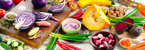 Raw vegetables. On wooden board. Healthy eating concept. Top view. Panorama Stock Photos