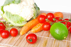 Raw vegetables on wooden mat Royalty Free Stock Images