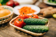 Raw vegetables on wooden table closeup, nobody. Healthy food concept Stock Image