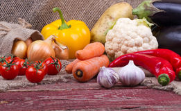 Raw vegetables on a wooden table Stock Photography