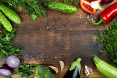 Raw vegetables on wooden texture background with copyspace in center royalty free stock image