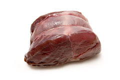 Raw venison meat. Isolated on a white studio background Royalty Free Stock Images