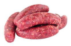 Raw Venison Meat Sausages. Group of fresh raw venison meat sausages isolated on a white background Stock Images