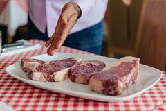 Raw wagyu beef cuts from left to right: T-Bone Steak, Rib Eye and Boneless Top Loin Steak. Royalty Free Stock Image