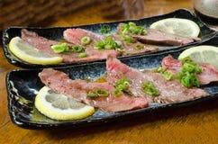 Raw Wagyu Beef- Japanese Style. Raw wagyu beef with shallot and lemon - Japanese style Royalty Free Stock Image