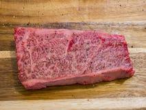 Raw Wagyu beef sit on a board