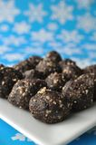 Raw walnut, date and cacao balls on a blue winter background with snow flakes Stock Photo
