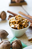 Raw walnuts in a white bowl, white background Stock Photography