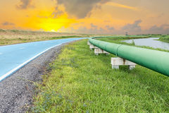 Raw water pipeline and distribution parallel of the road. Stock Photos