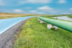 Raw water pipeline and distribution parallel of the road. Tools equipment royalty free stock photos