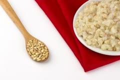 Raw wheat and wheat porridge Royalty Free Stock Image
