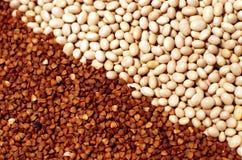 Raw white beans and buckwheat diagonal Royalty Free Stock Photos