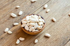 Raw White Beans. Organic Raw White Beans in wooden bowl close up - healthy ingredient for diet vegan vegetarian protein food meal cuisine, ready for cooking Stock Image